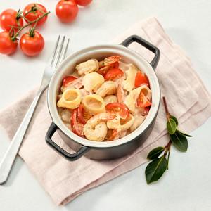 Cassolette au four de coquillettes avec Boursin® Cuisine Tomates & Herbes aux scampis