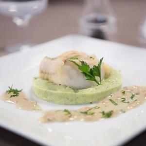 Witte visfilet dugléré met courgettepuree op Provençaalse wijze